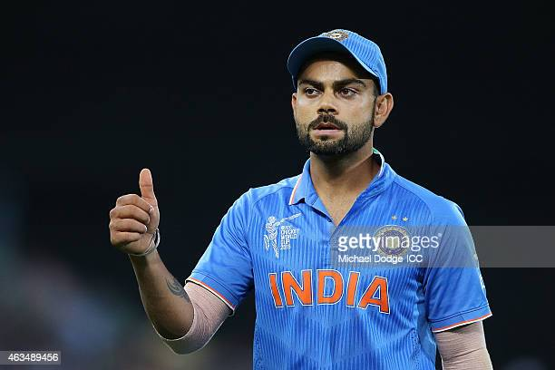 Virat Kohli of India thanks fans after their win during the 2015 ICC Cricket World Cup match between India and Pakistan at Adelaide Oval on February...