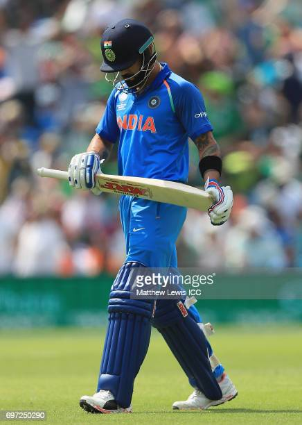 Virat Kohli of India walks off after he was caught by Shadab Khan of Pakistan off the bowling of Mohammad Amir during the ICC Champions Trophy Final...