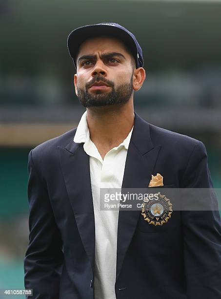 Virat Kohli of India walks out for the coin toss during day one of the Fourth Test match between Australia and India at Sydney Cricket Ground on...