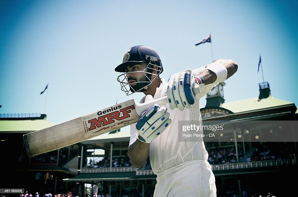 <a gi-track='captionPersonalityLinkClicked' href=/galleries/search?phrase=Virat+Kohli&family=editorial&specificpeople=4880246 ng-click='$event.stopPropagation()'>Virat Kohli</a> of India walks out to bat during day three of the Fourth Test match between Australia and India at Sydney Cricket Ground on January 8, 2015 in Sydney, Australia.