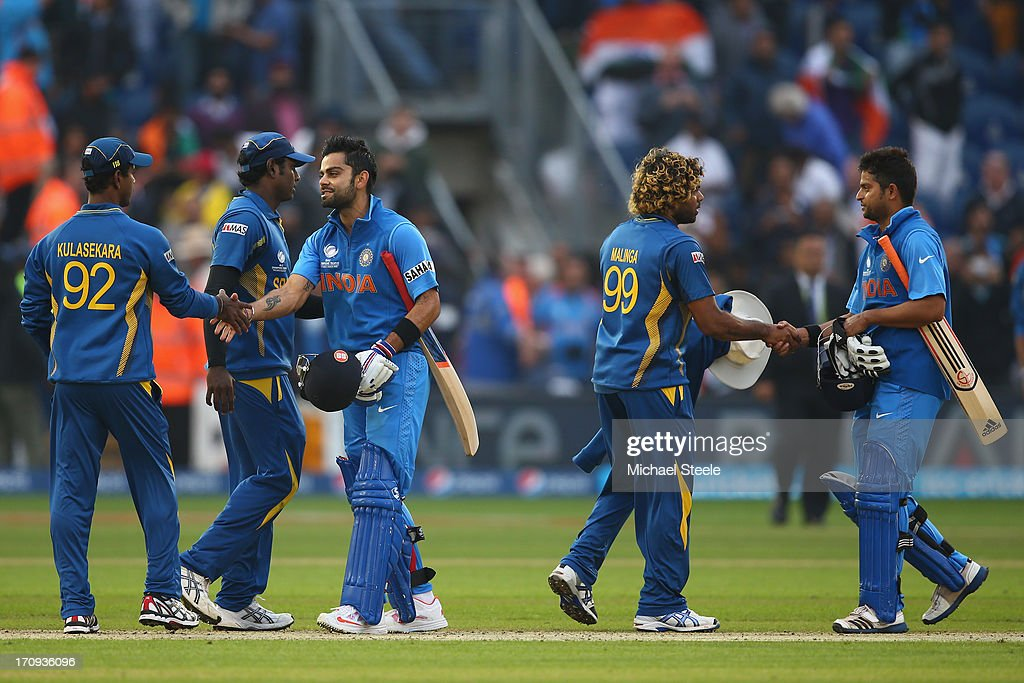 <a gi-track='captionPersonalityLinkClicked' href=/galleries/search?phrase=Virat+Kohli&family=editorial&specificpeople=4880246 ng-click='$event.stopPropagation()'>Virat Kohli</a> (3L) of Indiashakes hands with Nuwan Kulasekera (L) of Sri Lanka as <a gi-track='captionPersonalityLinkClicked' href=/galleries/search?phrase=Suresh+Raina&family=editorial&specificpeople=542210 ng-click='$event.stopPropagation()'>Suresh Raina</a> (R) of India shakes hands with <a gi-track='captionPersonalityLinkClicked' href=/galleries/search?phrase=Lasith+Malinga&family=editorial&specificpeople=171602 ng-click='$event.stopPropagation()'>Lasith Malinga</a> (2R) after India's eight wicket victory during the ICC Champions Trophy Semi-Final match between India and Sri Lanka at the SWALEC Stadium on June 20, 2013 in Cardiff, Wales.