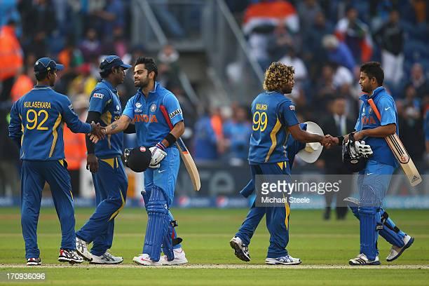Virat Kohli of Indiashakes hands with Nuwan Kulasekera of Sri Lanka as Suresh Raina of India shakes hands with Lasith Malinga after India's eight...