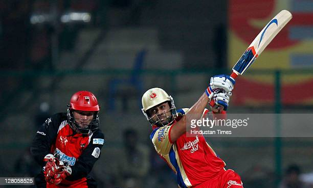 Virat Kohli of Royal Challenge Bangalore hits the ball during the Champions League Twenty20 Group B match between Royal Challengers Bangalore v South...