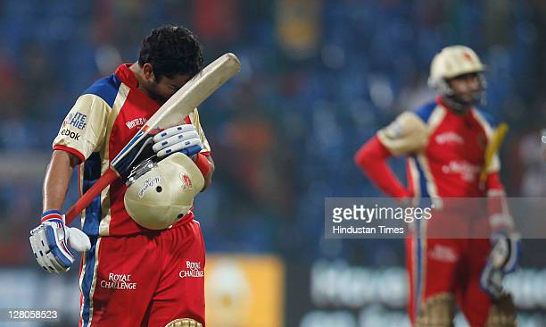 Virat Kohli of Royal Challenge Bangalore walks back after being dismissed for 70 runs off just 36 balls during the Champions League Twenty20 Group B...