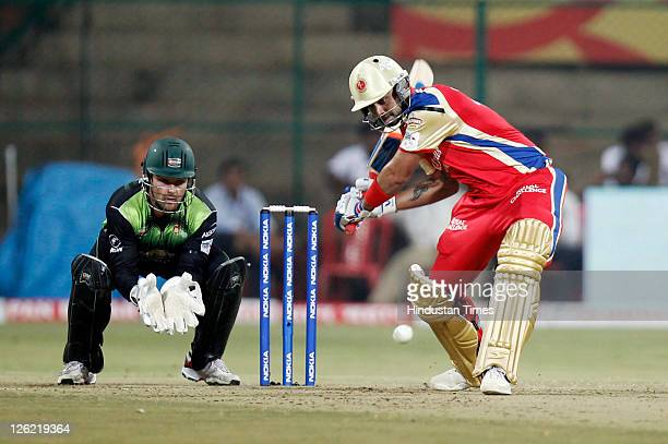 Virat Kohli of Royal Challenger Bengalore plays a shot during the Champions League Twenty20 Group B match between Royal Challengers Bangalore and...