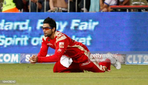 Virat Kohli of Royal Challengers takes a catch during the Airtel Champions League Twenty20 semi final match between Chennai Super Kings and Royal...