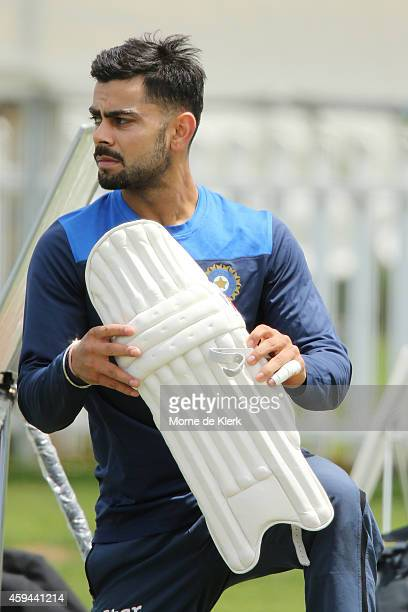 Virat Kohli puts his pads on during a training session for the Indian cricket team at Gliderol Stadium on November 23 2014 in Adelaide Australia