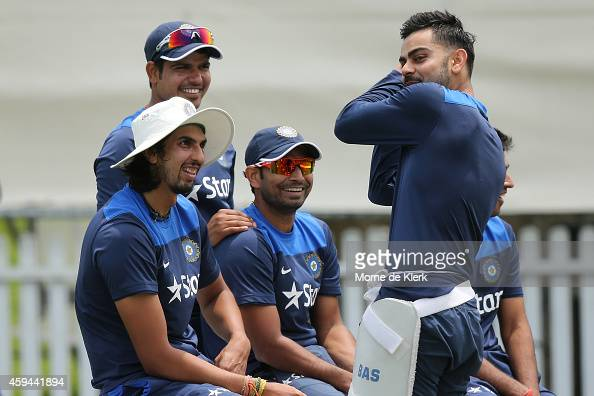 Virat Kohli speaks to his teammates during a training session for the Indian cricket team at Gliderol Stadium on November 23 2014 in Adelaide...