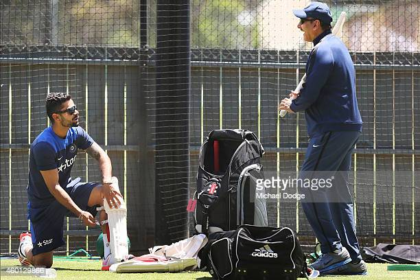 Virat Kohli talks to India Director of Cricket Ravi Shastri who reacts during an India Training Session at Adelaide Oval on December 8 2014 in...