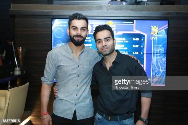Virat Kohli with his brother Vikas Kohli during special dinner for Royal Challengers Bangalore teammates by Virat Kohli at his new restaurant Nueva...