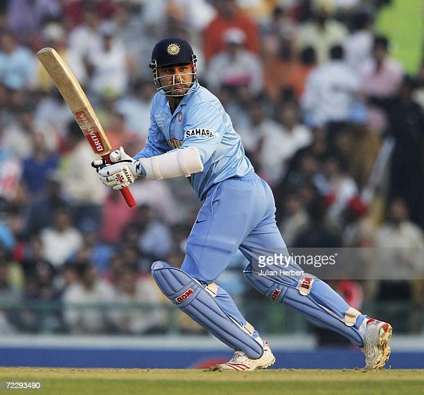 Virenda Sehwag of India in action against the Australian attack during the ICC Champions Trophy match between Austalia and India at The Punjab...