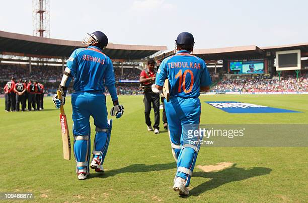 Virender Sehwag and Sachin Tendulkar of India enter the stadium during the 2011 ICC World Cup Group B match between India and England at M...