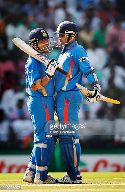 Virender Sehwag and Sachin Tendulkar of India talk amongst themselves during the Group B ICC World Cup Cricket match between India and South Africa...