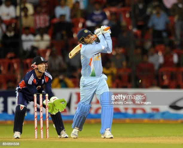 Virender Sehwag hits a boundary during the Fourth One Day International at M Chinnaswamy Stadium Bangalore India