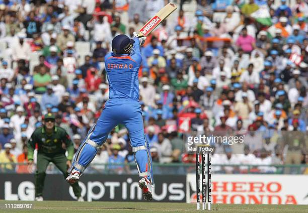 Virender Sehwag in action during the first innings of the ICC cricket world cup semifinal match between India and Pakistan at PCA stadium in Mohali