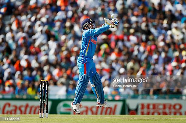 Virender Sehwag of India bats during the 2011 ICC World Cup second SemiFinal between India and Pakistan at Punjab Cricket Association Stadium on...
