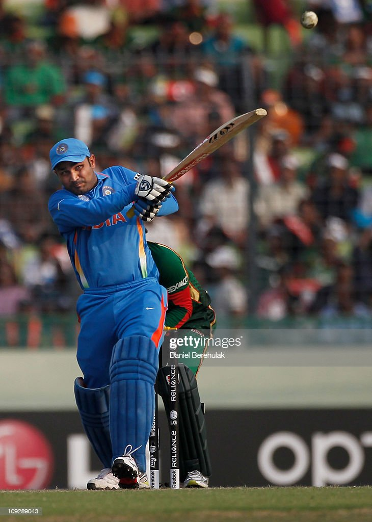 <a gi-track='captionPersonalityLinkClicked' href=/galleries/search?phrase=Virender+Sehwag&family=editorial&specificpeople=176591 ng-click='$event.stopPropagation()'>Virender Sehwag</a> of India bats during the opening game of the ICC Cricket World Cup between Bangladesh and India at the Shere-e-Bangla National Stadium on February 19, 2011 in Dhaka, Bangladesh.