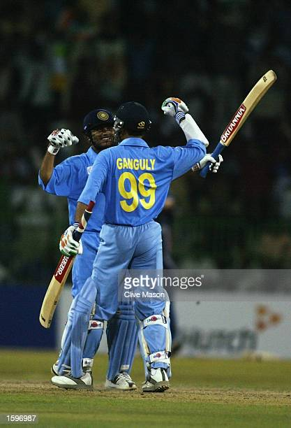 Virender Sehwag of India celebrates his century with Sourav Ganguly of India during the ICC Champions Trophy match between England and India at the R...