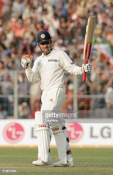 Virender Sehwag of India celebrates his half century during Day 2 of the second test between India and South Africa at Eden Gardens November 29 2004...