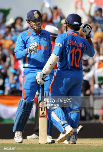 Virender Sehwag of India celebrates with team mate Sachin Tendulkar during the Group B ICC World Cup Cricket match between India and South Africa at...