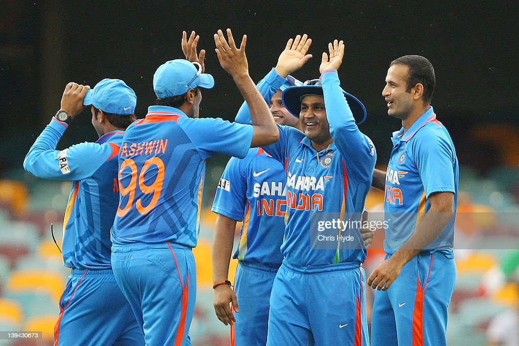 <a gi-track='captionPersonalityLinkClicked' href=/galleries/search?phrase=Virender+Sehwag&family=editorial&specificpeople=176591 ng-click='$event.stopPropagation()'>Virender Sehwag</a> of India celebrates with team mates after catching Mahela Jayawardena of Sri Lanka during game eight of the One Day International Series between India and Sri Lanka at The Gabba on February 21, 2012 in Brisbane, Australia.