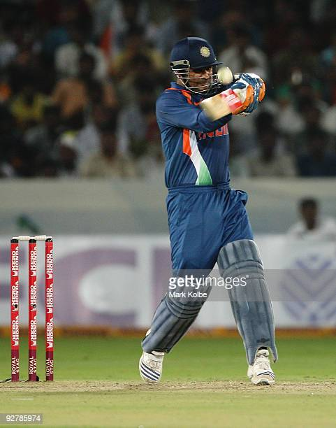 Virender Sehwag of India gets a top edge during the fifth One Day International match between India and Australia at Rajiv Gandhi International...
