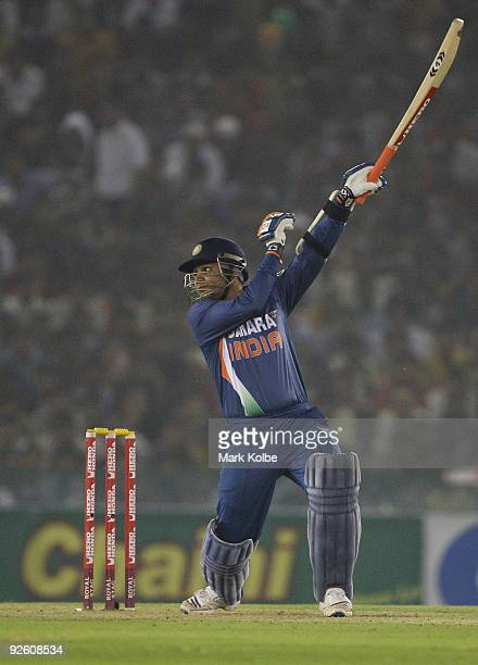 Virender Sehwag of India hits out during the fourth One Day International match between India and Australia at Punjab Cricket Association Stadium on...
