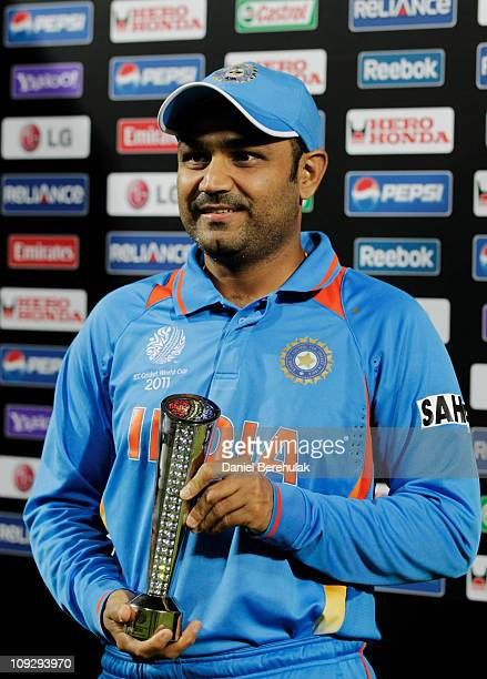 Virender Sehwag of India holds the Man Of The Match trophy during the opening game of the ICC Cricket World Cup between Bangladesh and India at the...