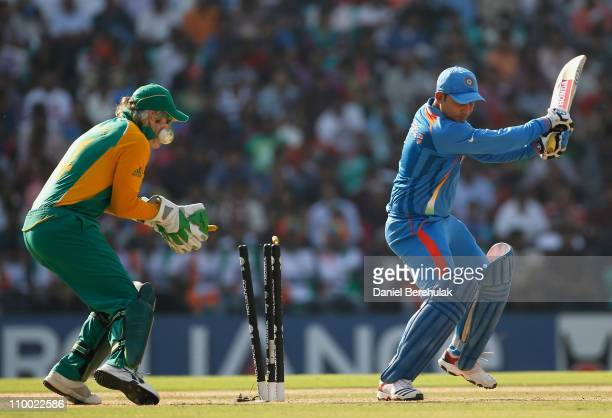 Virender Sehwag of India is bowled by Faf du Plessis of South Africa during the Group B ICC World Cup Cricket match between India and South Africa at...