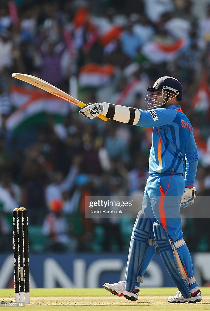 <a gi-track='captionPersonalityLinkClicked' href=/galleries/search?phrase=Virender+Sehwag&family=editorial&specificpeople=176591 ng-click='$event.stopPropagation()'>Virender Sehwag</a> of India lifts his bat on scoring his half century during the Group B ICC World Cup Cricket match between India and South Africa at Vidarbha Cricket Association Ground on March 12, 2011 in Nagpur, India.