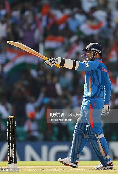 Virender Sehwag of India lifts his bat on scoring his half century during the Group B ICC World Cup Cricket match between India and South Africa at...