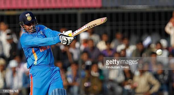 Virender Sehwag of India playing a shot during the 4th One Day International between India and West Indies at Holkar Stadium on December 8 2011 in...