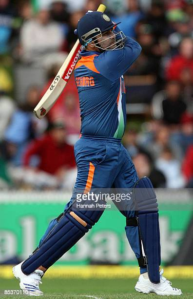 Virender Sehwag of India pulls the ball away for four runs during the fourth one day international match between the New Zealand Black Caps and India...