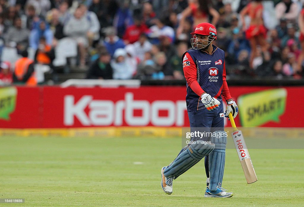 <a gi-track='captionPersonalityLinkClicked' href=/galleries/search?phrase=Virender+Sehwag&family=editorial&specificpeople=176591 ng-click='$event.stopPropagation()'>Virender Sehwag</a> of the Delhi Daredevils leaves the field after being dismissed during the Champions league twenty20 match between Perth Scorchers and Delhi Daredevils at Sahara Park Newlands on October 21, 2012 in Cape Town, South Africa.