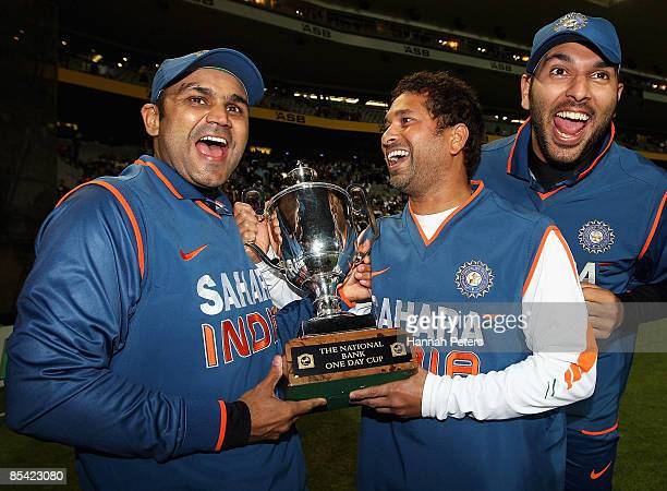 Virender Sehwag Sachin Tendulkar and Yuvraj Singh celebrate after wining the series 31 after the fifth one day international match between the New...