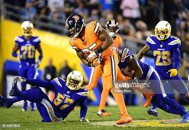 Virgil Green of the Denver Broncos is tackled by Korey Toomer of the San Diego Chargers as Jatavis Brown looks on during the fourth quarter of a 2113...