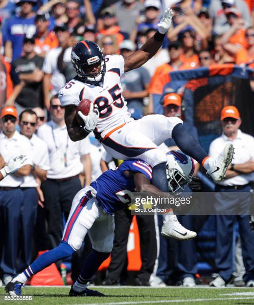 Virgil Green of the Denver Broncos is tackled by Tre'Davious White of the Buffalo Bills during the first quarter on September 24 2017 at New Era...