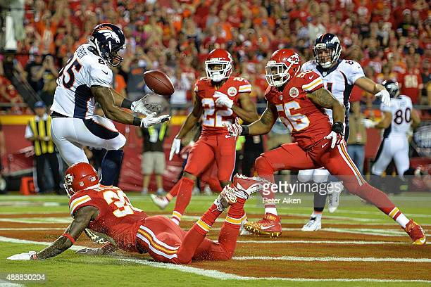 Virgil Green of the Denver Broncos makes a catch for a touchdown around defenders Derrick Johnson Marcus Peters and Husain Abdullah of the Kansas...