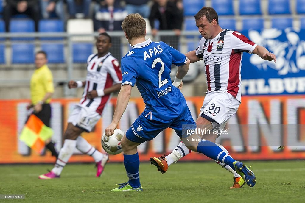 Virgil Misidjan of Willem II , Mattias Johansson of AZ , Nicky Hofs of Willem II during the Dutch Eredivisie match between Willem II and AZ Alkmaar on May 12, 2013 at the Koning Willem II stadium in Tilburg, The Netherlands.