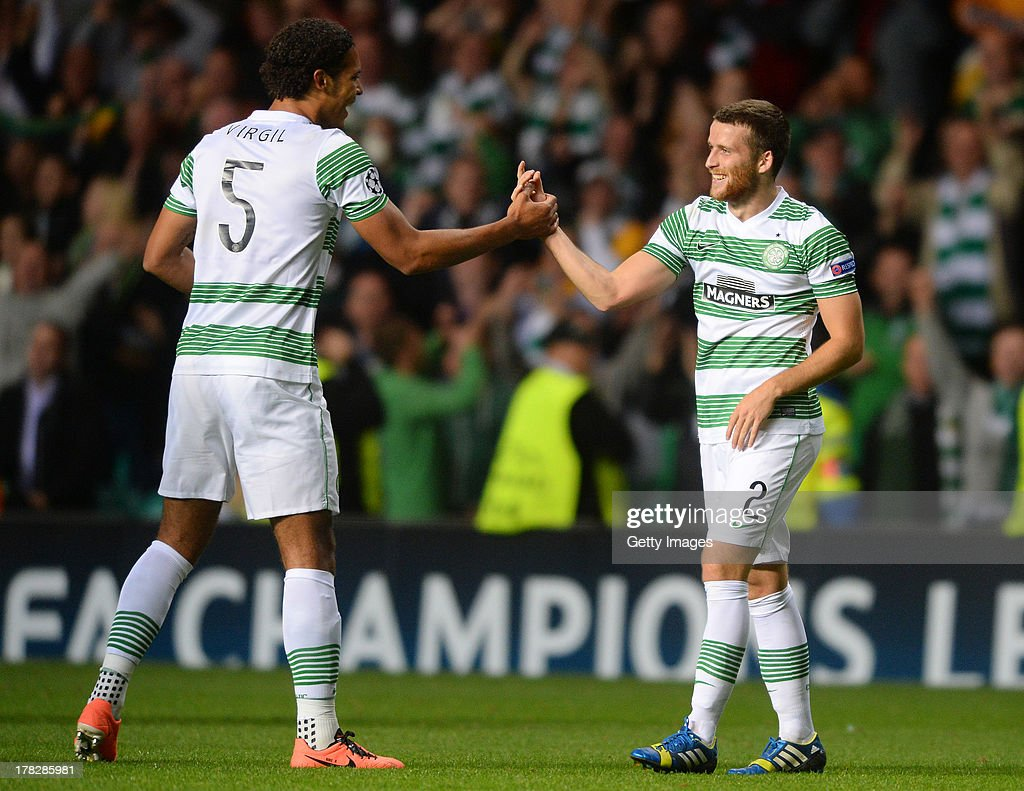 Virgil Van Dijk and Adam Matthews (R) of Celtic celebrate victory after the UEFA Champions League Play Off Round Second Leg match between Celtic and FC Shakhter Karagandy at Celtic Park Stadium on August 28, 2013 in Glasgow, Scotland.