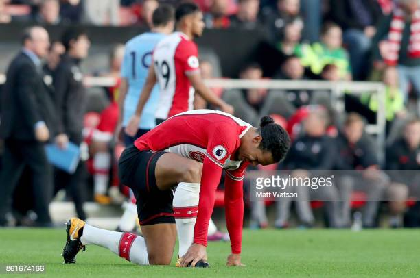 Virgil Van Dijk feels the affects of a tackle during the Premier League match between Southampton and Newcastle United at St Mary's Stadium on...