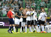 Virgil Van Dijk of Celtic discuses with Tomasz Jodlowiec of Legia during the third qualifying round UEFA Champions League match between Legia and...
