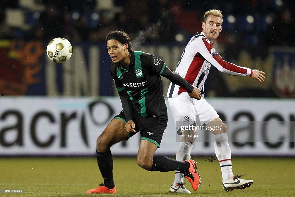 Virgil van Dijk of FC Groningen (L), Aurelien Joachim of Willem II (R) during the Dutch Eredivisie match between Willem II and FC Groningen at the Koning Willem II Stadium on march 30, 2013 in Tilburg, The Netherlands