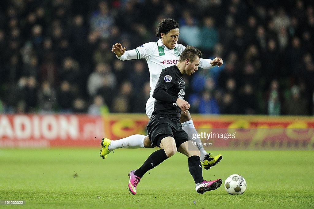 Virgil van Dijk of FC Groningen, Teddy Chevalier of RKC Waalwijk, during the Dutch Eredivisie match between FC Groningen and RKC Waalwijk at the Euroborg on february 9, 2013 in Groningen, The Netherlands