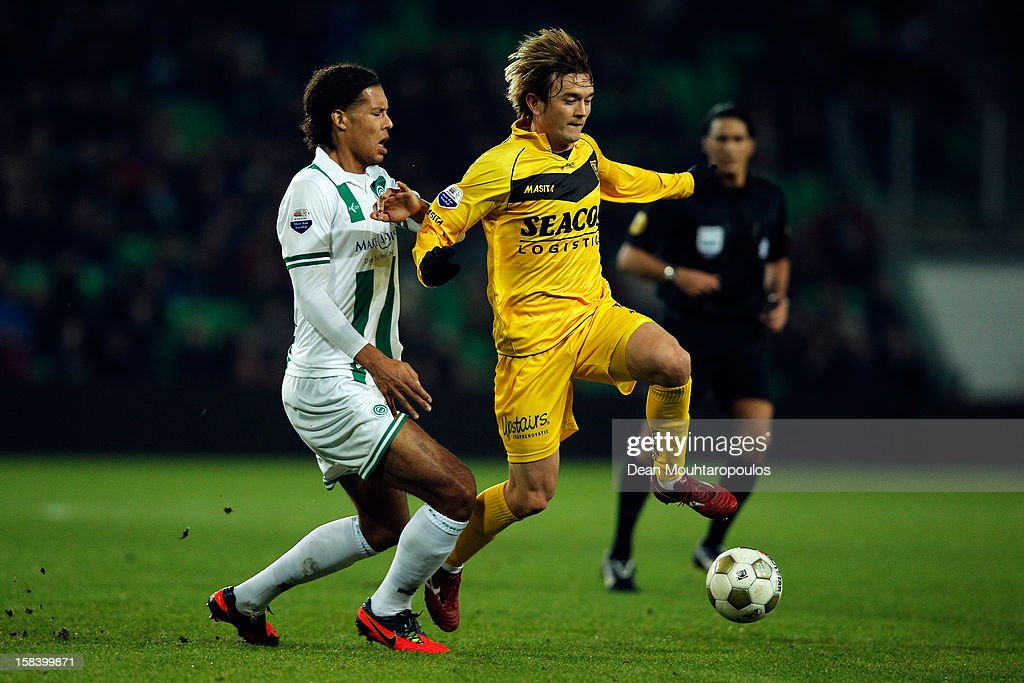 Virgil van Dijk of Groningen and Robert Cullen of Venlo battle for the ball during the Eredivisie match between FC Groningen and VVV Venlo at the Euroborg Stadium on December 15, 2012 in Groningen, Netherlands.