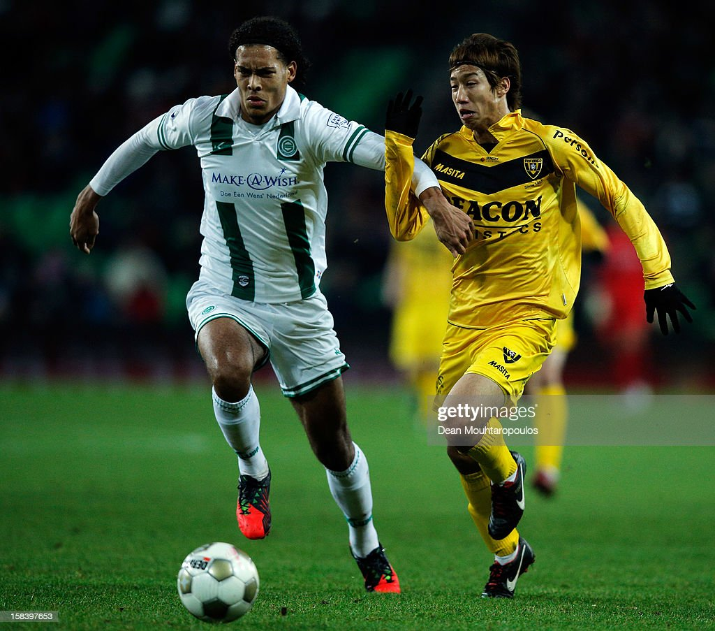 Virgil van Dijk of Groningen and <a gi-track='captionPersonalityLinkClicked' href=/galleries/search?phrase=Yuki+Otsu&family=editorial&specificpeople=7538227 ng-click='$event.stopPropagation()'>Yuki Otsu</a> of Venlo battle for the ball during the Eredivisie match between FC Groningen and VVV Venlo at the Euroborg Stadium on December 15, 2012 in Groningen, Netherlands.
