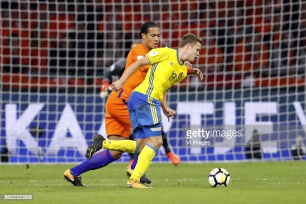 Virgil van Dijk of Holland Viktor Claesson of Sweden during the FIFA World Cup 2018 qualifying match between The Netherlands and Sweden at the...