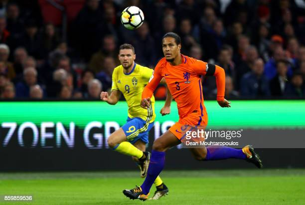 Virgil Van Dijk of Netherlands and Marcus Berg of Sweden in action during the FIFA 2018 World Cup Qualifier between Netherlands and Sweden at the...