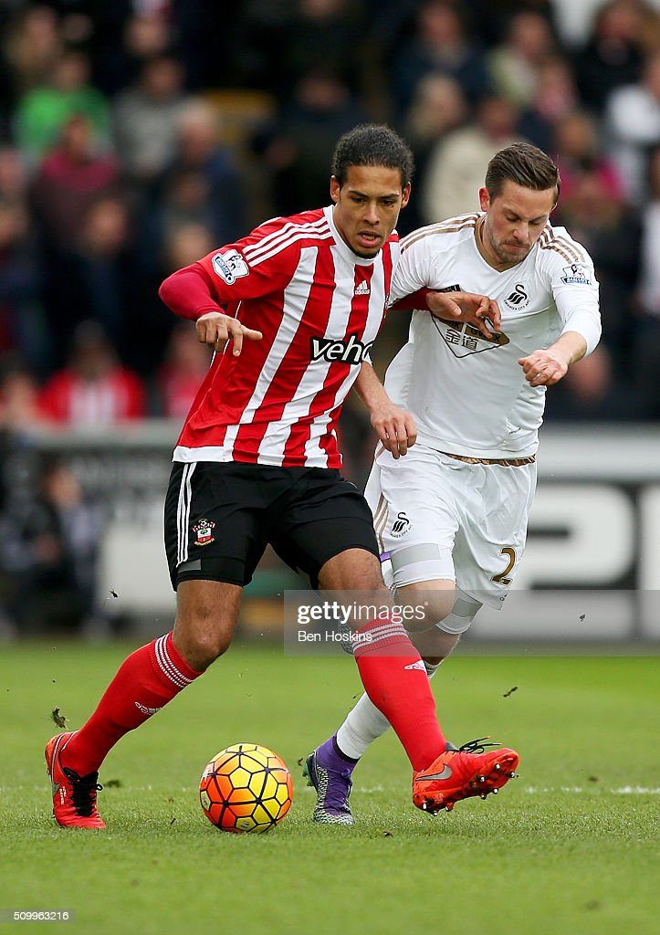 <a gi-track='captionPersonalityLinkClicked' href=/galleries/search?phrase=Virgil+van+Dijk&family=editorial&specificpeople=7826834 ng-click='$event.stopPropagation()'>Virgil van Dijk</a> of Southampton and <a gi-track='captionPersonalityLinkClicked' href=/galleries/search?phrase=Gylfi+Sigurdsson&family=editorial&specificpeople=6401581 ng-click='$event.stopPropagation()'>Gylfi Sigurdsson</a> of Swansea City compete for the ball during the Barclays Premier League match between Swansea City and Southampton at Liberty Stadium on February 13, 2016 in Swansea, Wales.