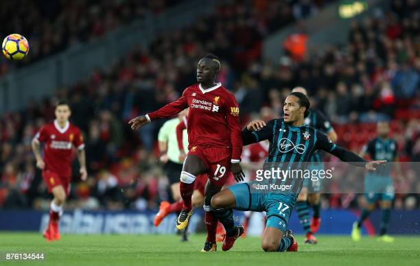 Virgil van Dijk of Southampton battles with Sadio Mane of Liverpool during the Premier League match between Liverpool and Southampton at Anfield on...